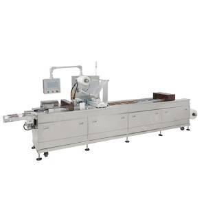 Automatic thermoforming vacuum packing machine