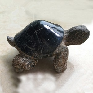 Hand carved stone turtle statue
