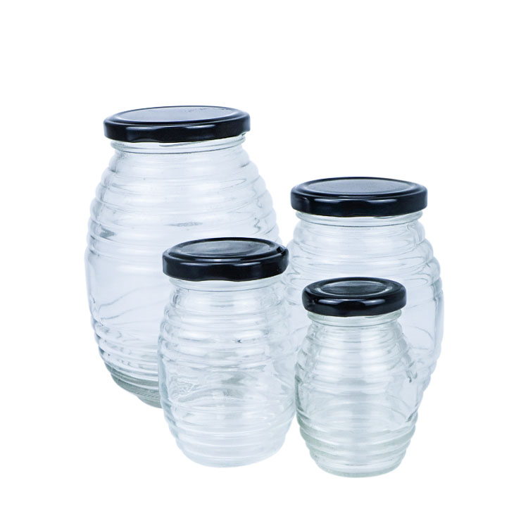 Transparent Round Glass Threaded Honey Jar with Tin Lid Featured Image