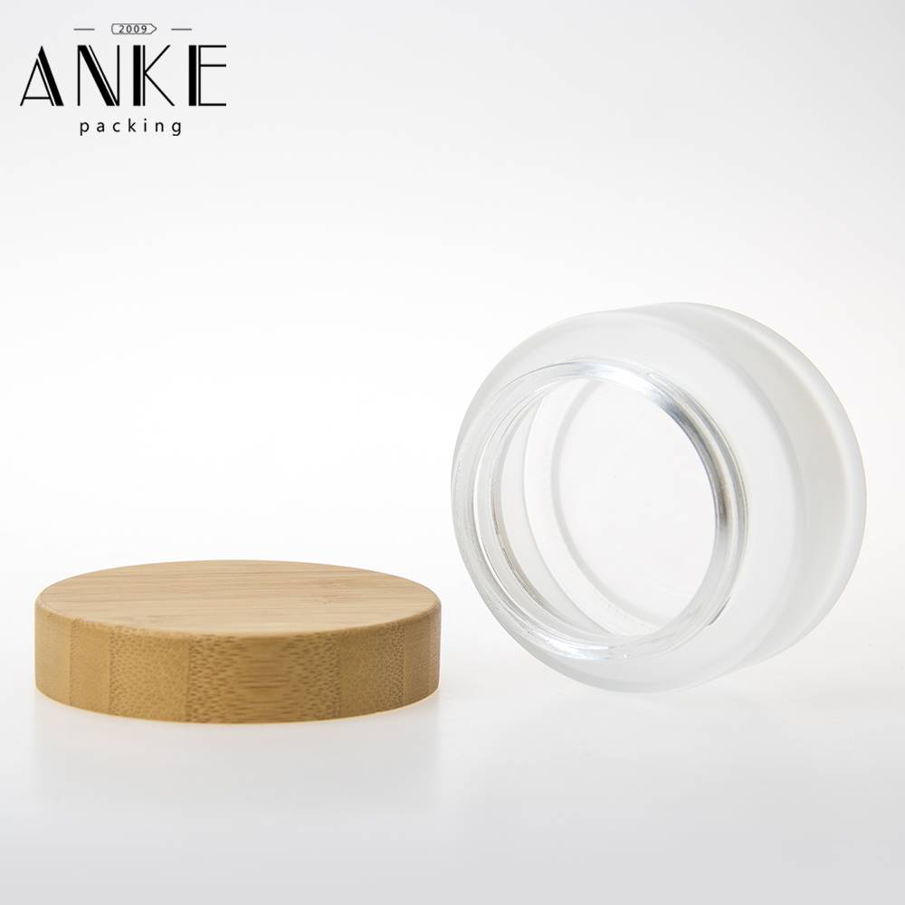 100g Frosted Glass Cream Jar with bamboo normal cap Featured Image
