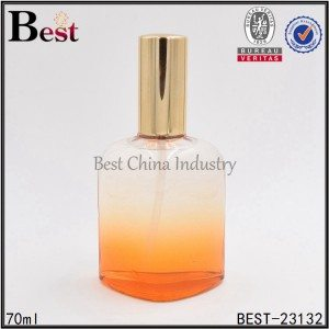 orange color triangle shape perfume bottle with gold aluminum sprayer 70ml