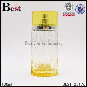 yellow clear oval perfume bottle with aluminum sprayer, yellow cap 100ml