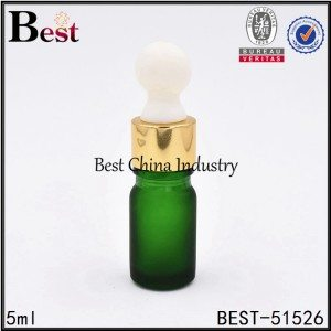frosted green glass essential oil bottle with shiny gold dropper, big rubber head 5ml