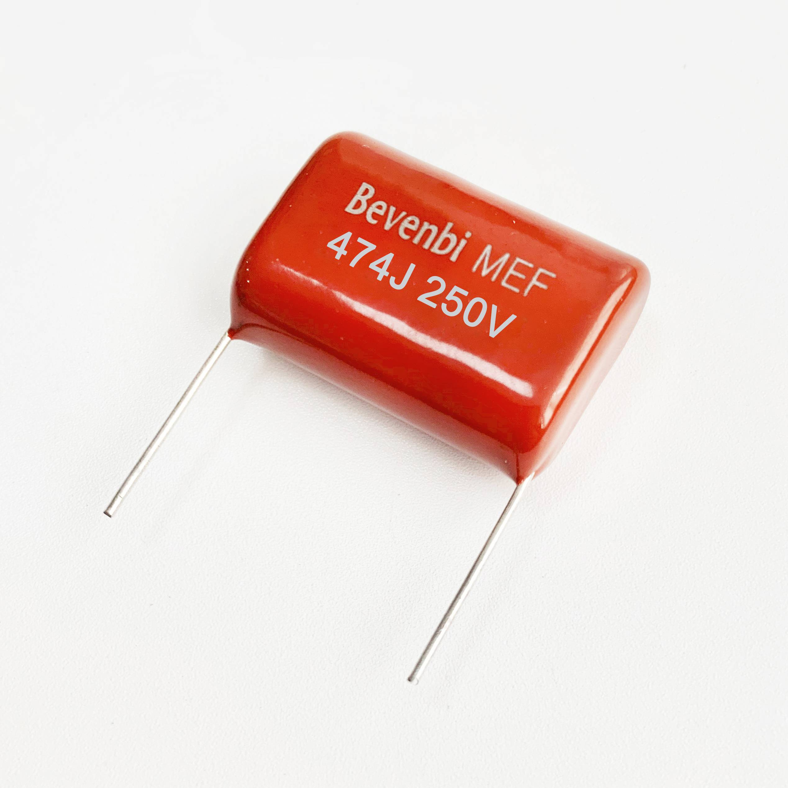 Cl21 Bevenbi metallized polyester film capacitor red radial type MEF Featured Image