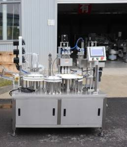 Test tube filling and capping machine