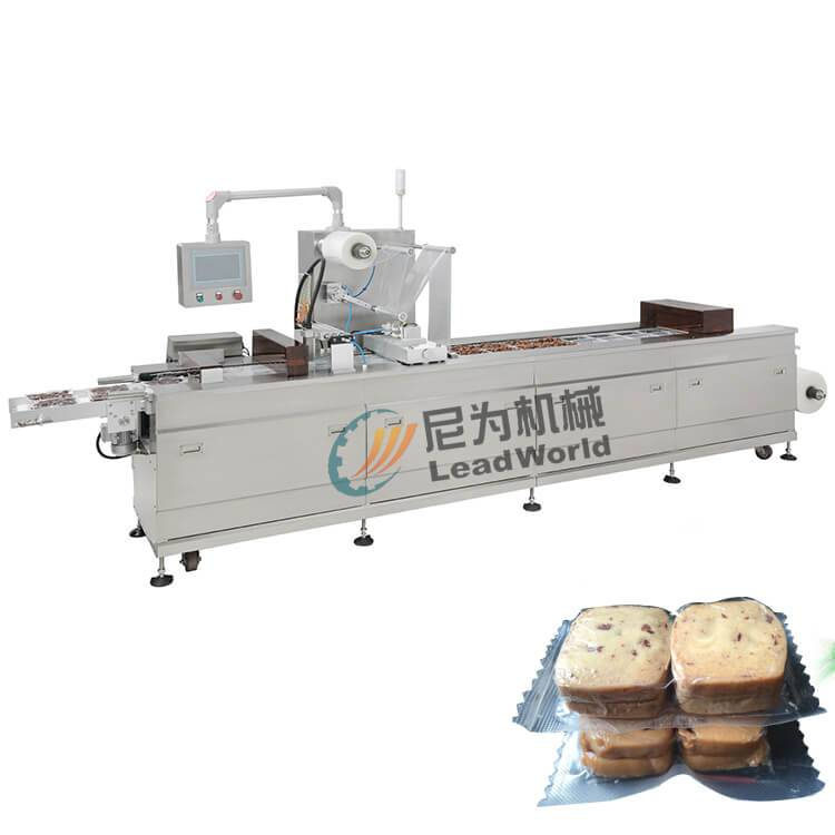 Manufactur standard Fruit In Syrup Processing Line - compressed biscuit cookie vacuum stretch film forming film packaging machine – Leadworld Machinery