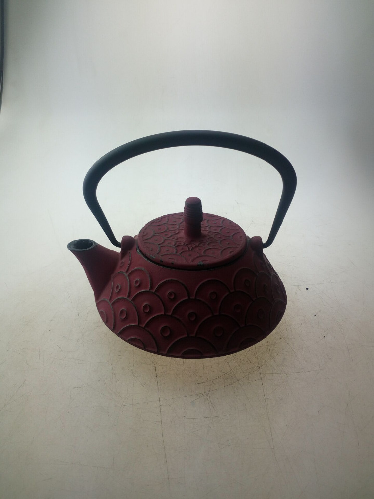 red color cast iron tea pot