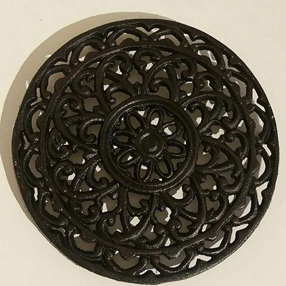 round decorative cast iron trivet to protect your table
