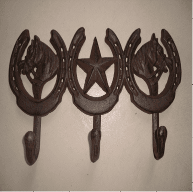 cast iron coat hook with star and two horse heads