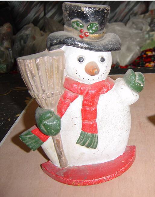 beautiful cast iron door stop snowman