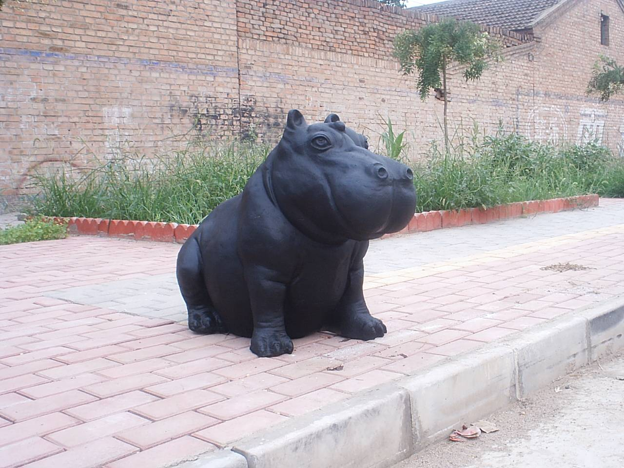 Rhinoceros Cast Iron Sculpture Featured Image