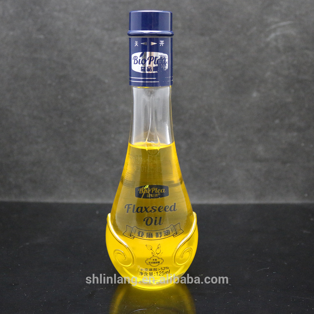 Shanghai linlang High-end Drop Shape Camellia and Olive Oil Glass Bottle