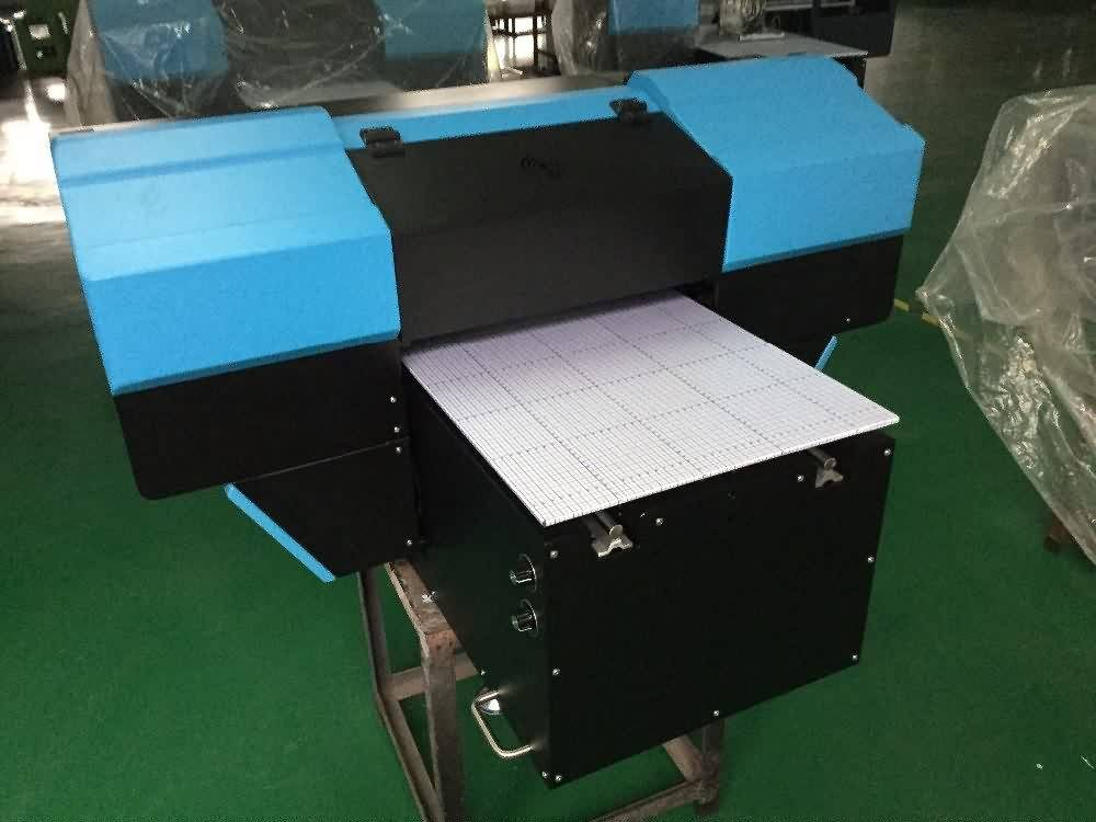 15 Years manufacturer Mini Desktop 450*900mm UV FLATBED PRINTER to Portugal Factories