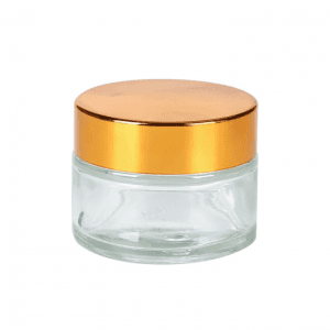 The transparent cosmetic glass jar