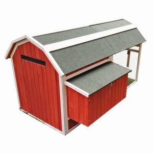 Red  wooden chicken coop with corners of the roof