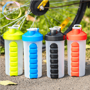 Outdoor portable creative pill box water bottle 700ML seven days pill box shake cup SKB1007