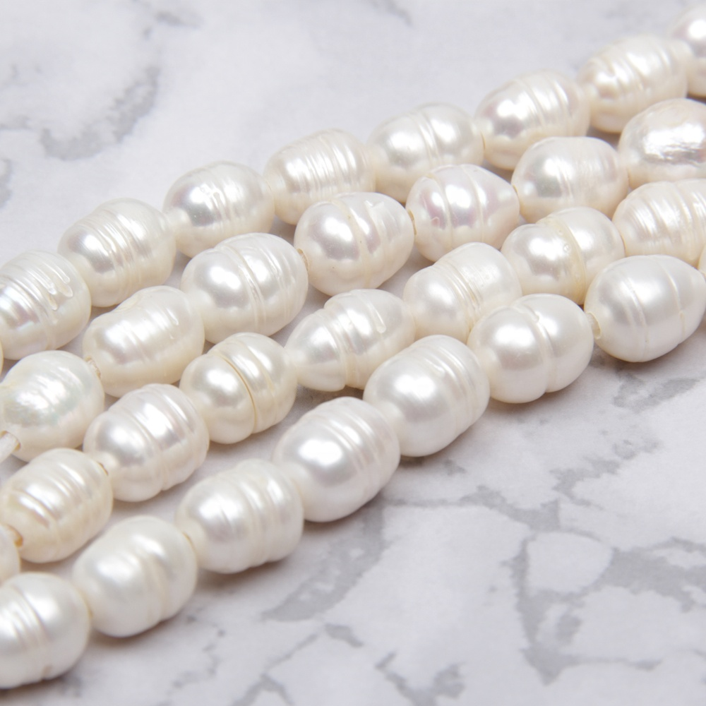 Chinese big 1.8mm hole strand 10-11mm real freshwater seed pearl