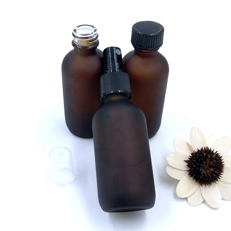 stock custom design 60ml empty matte amber boston round packaging 2oz frosted brown glass bottle with black sprayer pump