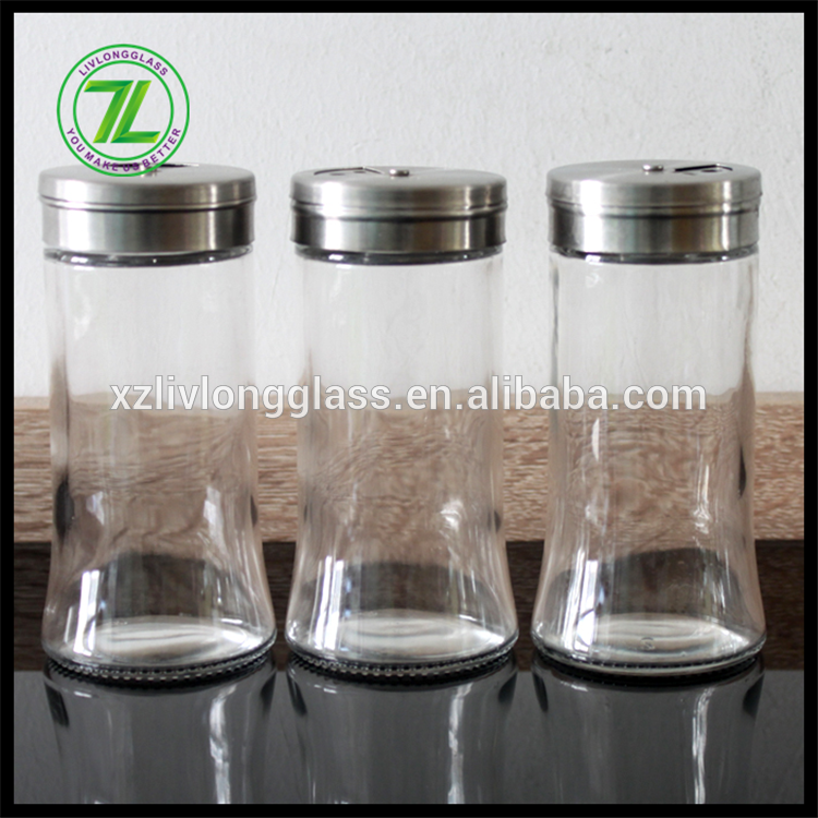 clear round glass jar with metal lid with hole on top