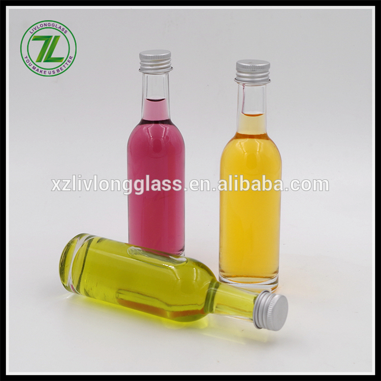 100ml high quality clear glass liquor bottle with aluminium silver lid