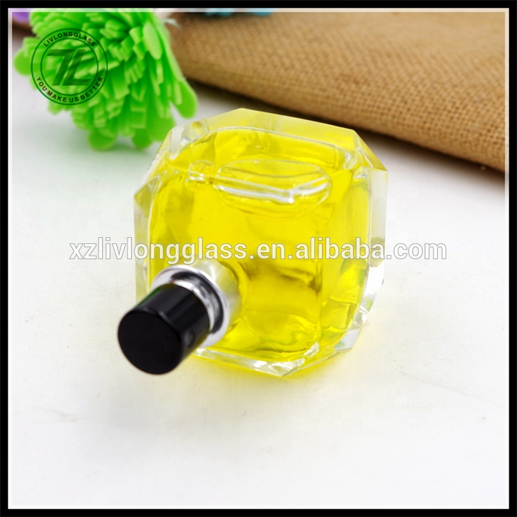 Best Price for 350ml Glass Bottle - 2017 NEW Unique Shape 50ml Clear Cosmetic Perfume Glass Bottles with Spray – LIVLONG