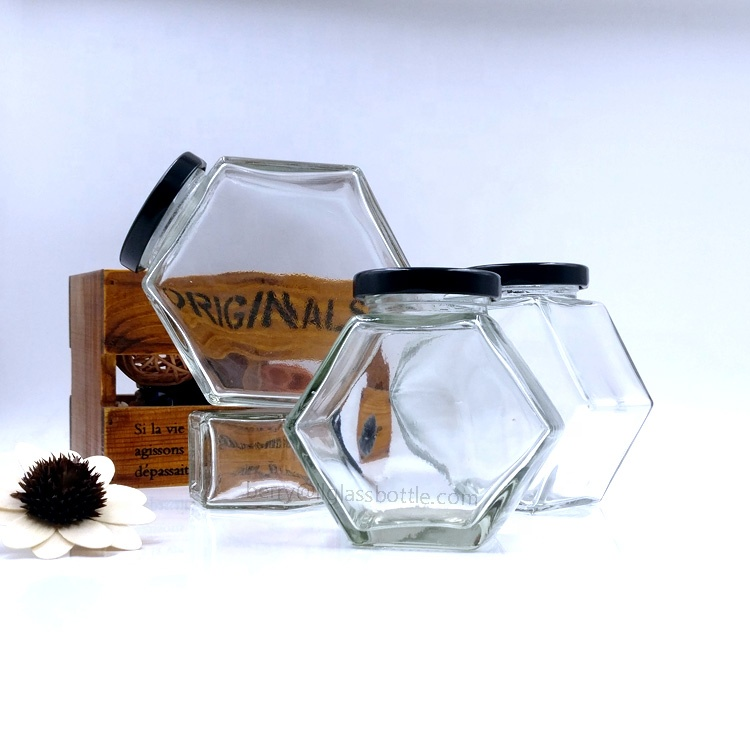 new honeycomb designs 180ml food grade bottle 250g honey empty glass hexagon jar for sale