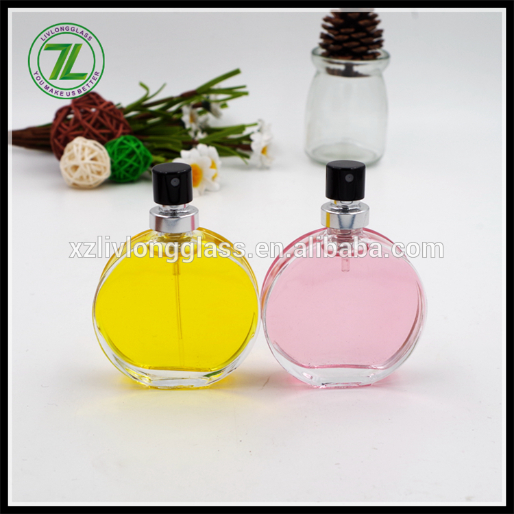 flat round glass perfume bottle