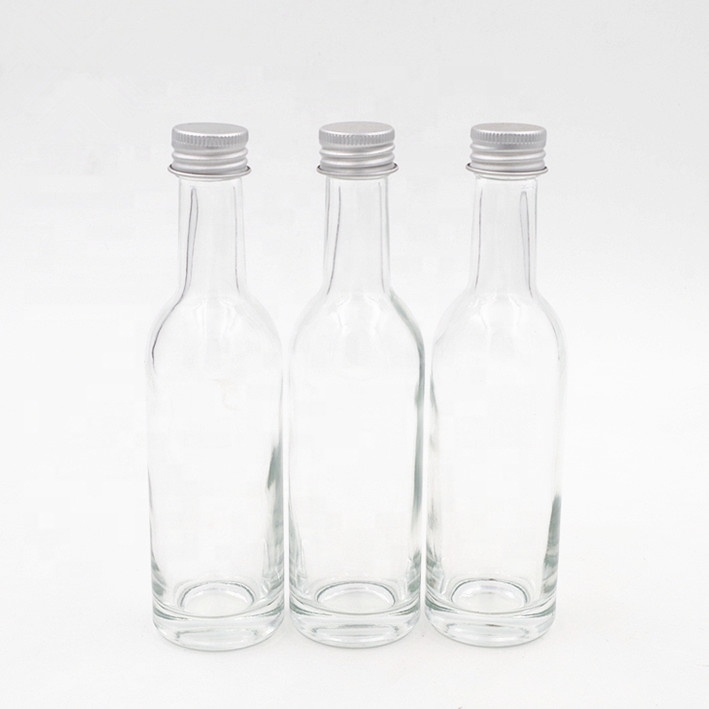 cheap clear Safflower oil glass bottle essential oil fruit juice bottle with aluminum screw lid for liquor and spirits trial