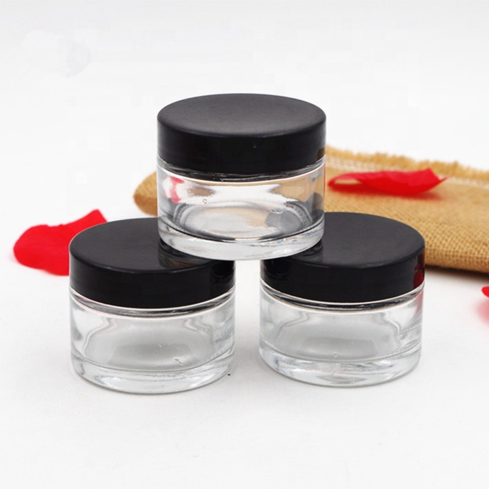 hot sale 30ml clear canned food travel packaging glass jar 1oz skin care cream cosmetic packaging glass jar with black lid