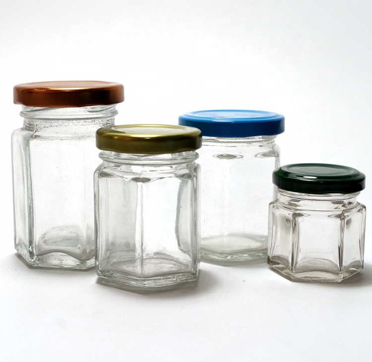 cheap stocked variety sizes hexagon polygon clear canister  glass bottle honey bee sauce pickle nut glass jar with color lug lid