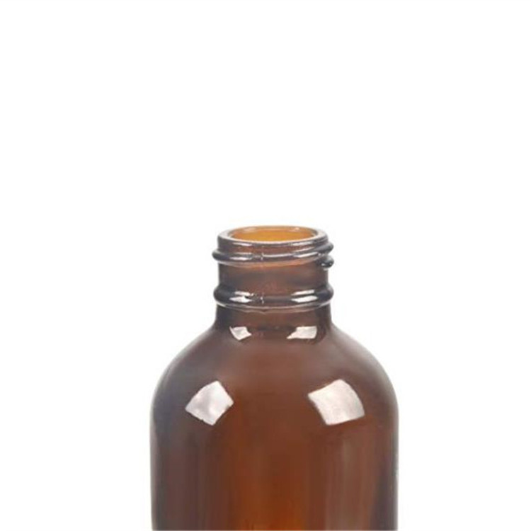 4oz Amber Boston Round Glass Bottle With Black Poly Cap
