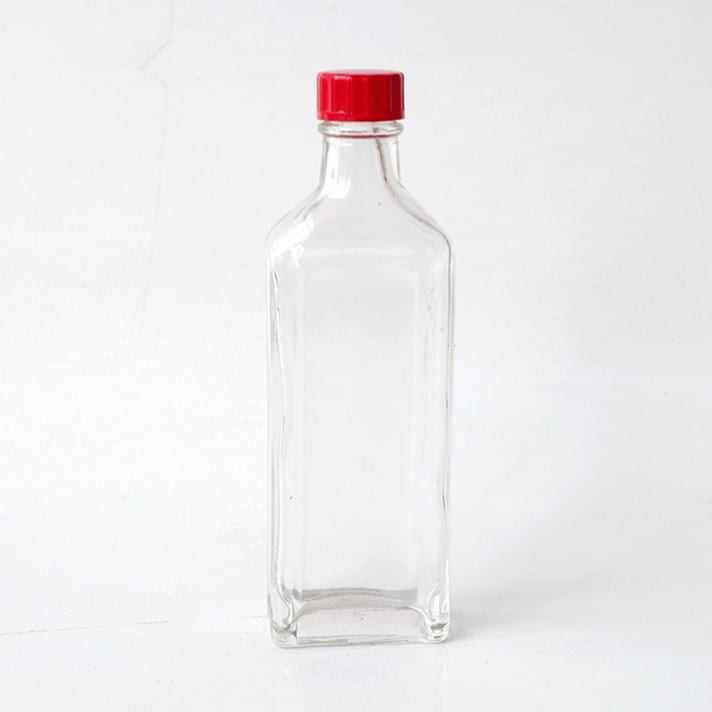 wholesale clear flat 30ml Safflower oil glass bottle essential oil bottle with red plastic screw lid for liquor and spirits