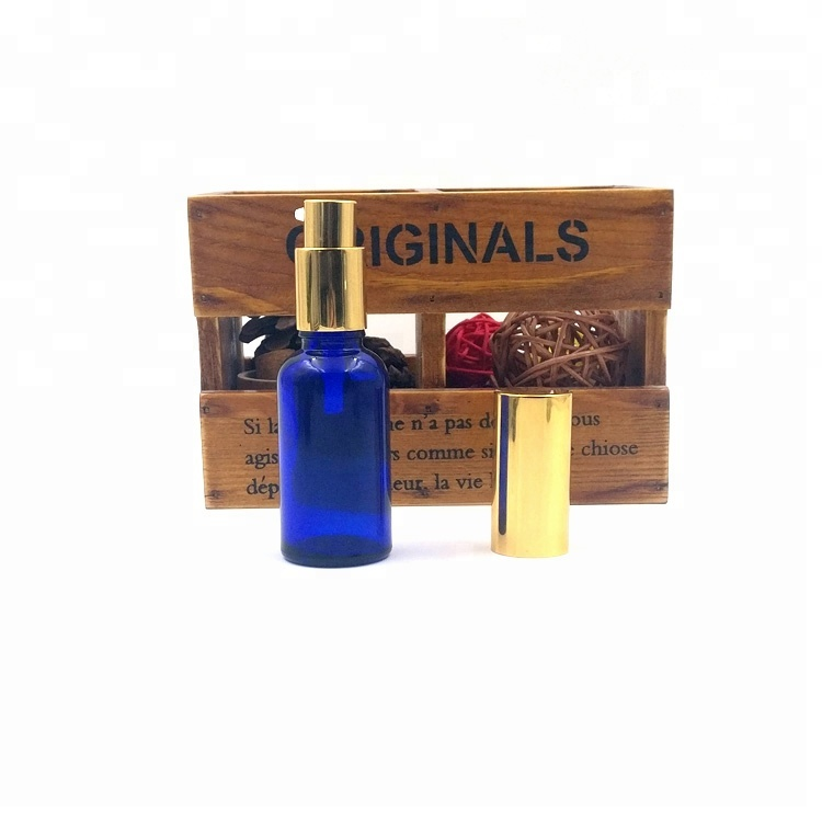 custom design 30ml essence lotion packaging 1oz empty glass blue bottle with pump