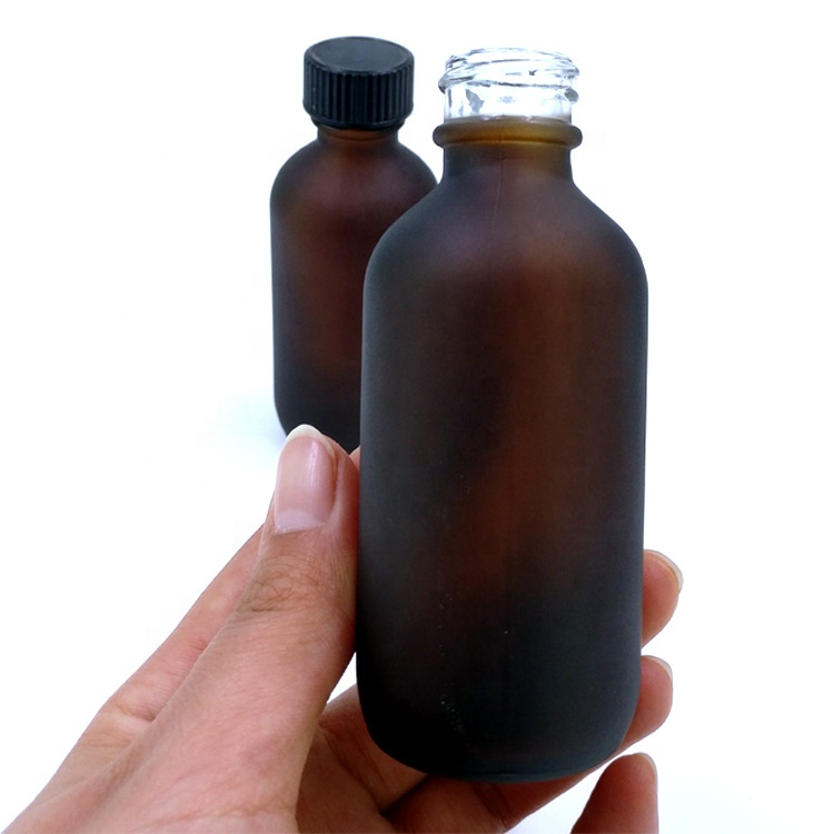 wholesale lighttight 60ml frosted brown essential oil boston round packaging 2oz airtight matte amber glass bottle for cosmetic