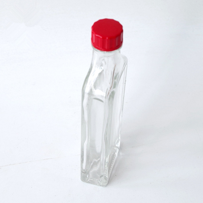 wholesale clear flat 50ml Safflower oil glass bottle essential oil bottle with red plastic screw lid for liquor and spirits
