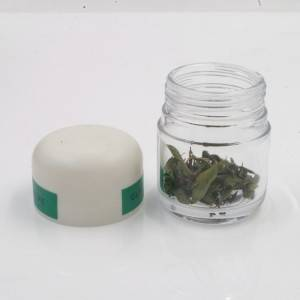 glass cannabis jar round base with child proof dome lid