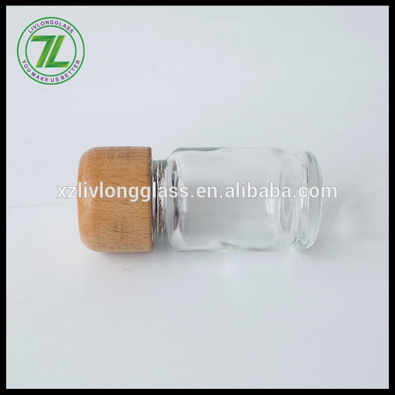 clear round glass salt bottle with wood screw lid