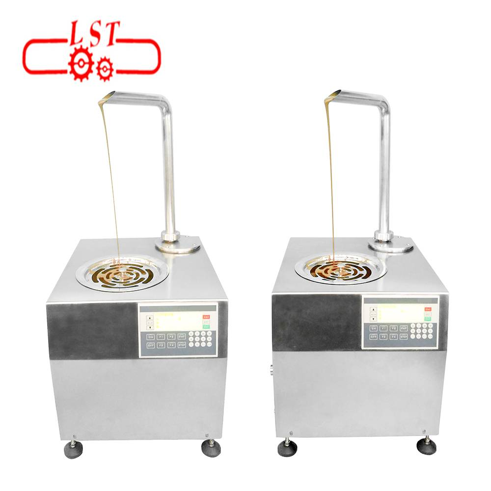 Small stainless steel chocolate tempering machine in chocolate cake shop
