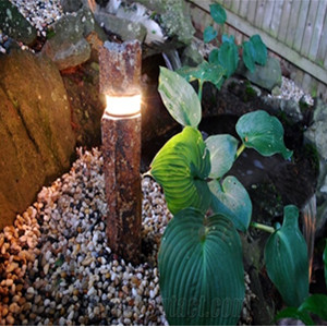 Basalt chiseled light for garden decor