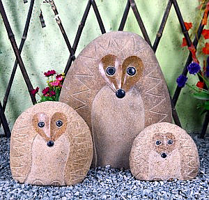 Garden carved stone hedgehog sculptures