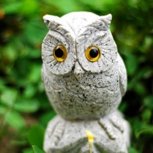 Decorative white owl figurines sculpture
