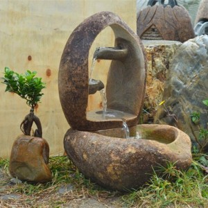 Tiers cobble stone water fountain outdoor
