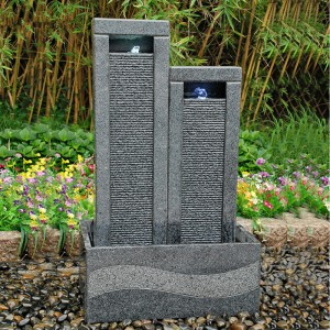 Height discrepancy artifical crystal granite stone water fountain in backyard
