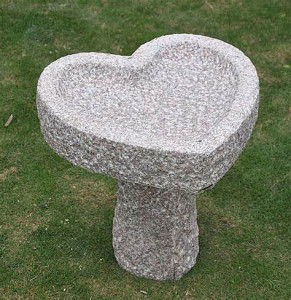 Basalt stone birdbath for garden decor