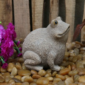 Carved stone frog decorative statue