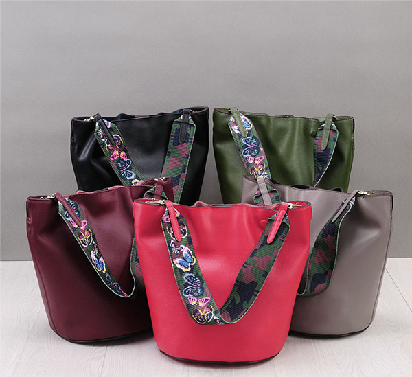 High Quality Ladies Soft Leather Bucket Bag With Colored Shoulder Strap Featured Image