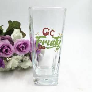 clear glass juice cup