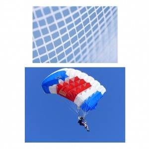 Non-woven laid scrims laminated for single parachute for reinforcement solutions