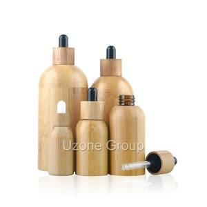 Essential oil bottle with bamboo cover and dropper