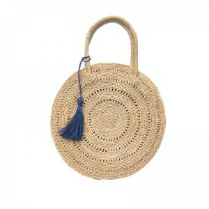 Big round handmade raffia straw bag with tassel